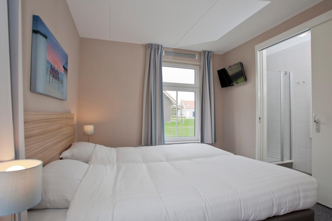 """6-Personen Kinder-Ferienhaus 6C1 """"Deichhaus"""" - """"Strand Resort Nieuwvliet-Bad"""""""